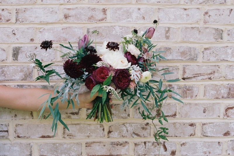 flower-bouquet-hand-holding-brickwall-floral